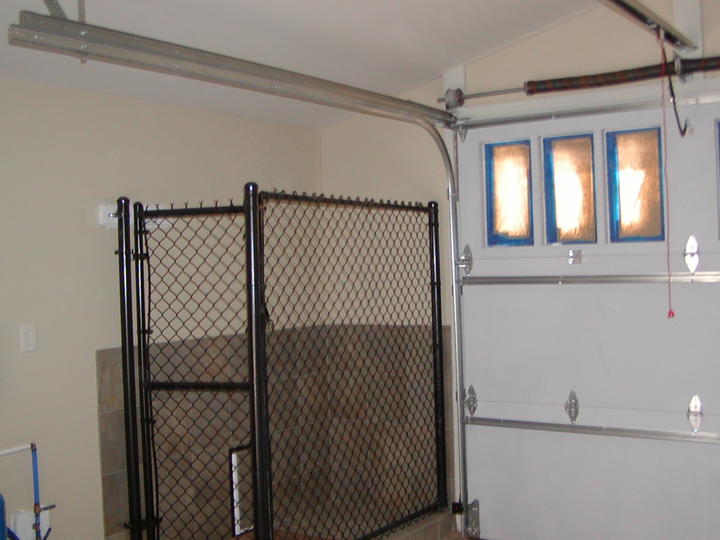 Ponds sons for Dog kennel in garage ideas